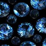 Set of round blue sapphire isolated on black backgroun — Stock Photo