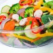 Fresh vegetables in electric food steamer — Stock Photo