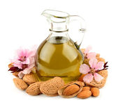 Almond oil and almond nuts — Stock Photo