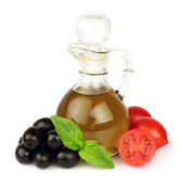 Olive oil with vegetables — Stock Photo