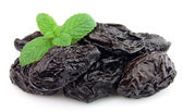 Prunes with mint — Stock Photo