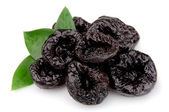 Prunes with leafs — Stock Photo