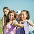 Two happy women with teens — Stock Photo #10518838