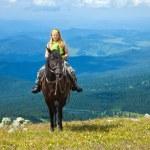 Rider on horseback at mountains — Stock Photo #10519233