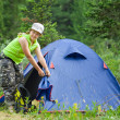 Stock Photo: Hiker in front of camp tent