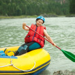 Girl on raft — Stock Photo #10519252
