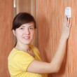Woman turning off the light switch — Stock Photo #10519940