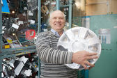 Mature man in auto parts store — Stock Photo