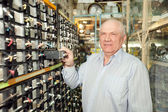 Man chooses fasteners in auto parts store — Stock Photo