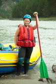 Girl with paddle — Stock Photo
