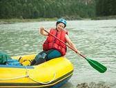 Girl on the raft — Stock Photo