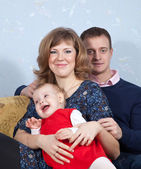 Happy parents with child — Stock Photo