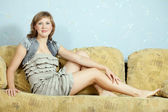 Sexy girl on sofa — Stock Photo