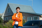 Happy woman in front of her residence — Stock Photo
