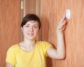 Woman turning off the light switch — Stock Photo