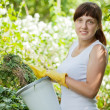 Female farmer making compost - Stock Photo