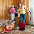 Family is cleans living room — Stock Photo