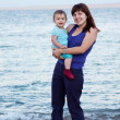 Mother with  toddler on beach — Stock Photo