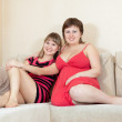 Stock Photo: Relaxed women resting on sofa