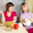 Girls have tea with   cookies — Stock Photo
