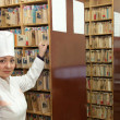 Стоковое фото: Nurse searching medical chart