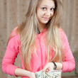 Happy girl with bundles of US dollars — Stock Photo #10528034
