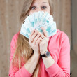 Happy girl with many roubles — Stock Photo