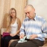 Quarrel in family over money — Stock Photo