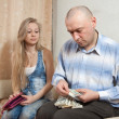 Stock Photo: Family quarrel over money