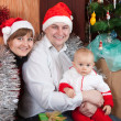 Family near Christmas tree — Stock Photo #10528407