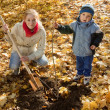 Family planting tree   in autumn — Stock Photo