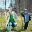 Family planting tree — Stockfoto #10528475