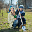 Stock Photo: Woman and boy with spade