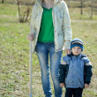 Stock Photo: Woman with son with spade