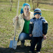 Woman and boy with spade — Stock Photo #10528481
