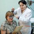 Ophthalmologist  and patient testing  eyesight - Stock Photo
