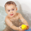 Toddler bathing  in bath - Stock Photo