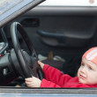 Baby girl driving  car — Stock Photo