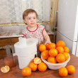 Baby girl making fresh orange juice — Stock Photo #10529828