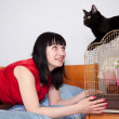 Woman with pets in home — Stock Photo