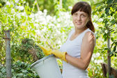 Female farmer making compost — Stock Photo