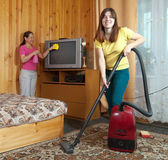 Women cleaning in living room — Stock Photo