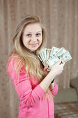 Happy girl with bundles of US dollars — Stock Photo
