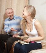 Happy family with mane US dollars — Stock Photo