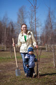 Woman with her son planting the tree — Stock Photo