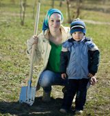 Woman and boy with spade — Stock Photo