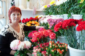 Woman in flowers shop — Stock Photo