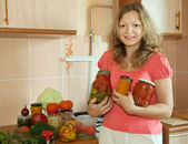 Woman with marinated vegetables — Photo
