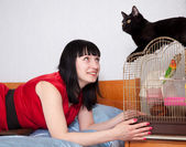 Woman with pets in home — Stok fotoğraf