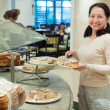 Woman takes fresh pastry — Stock Photo #10530099